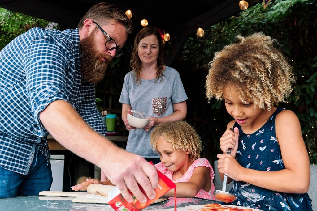 Whole family baking pizza during a family photo shoot in Hayes Bromley London
