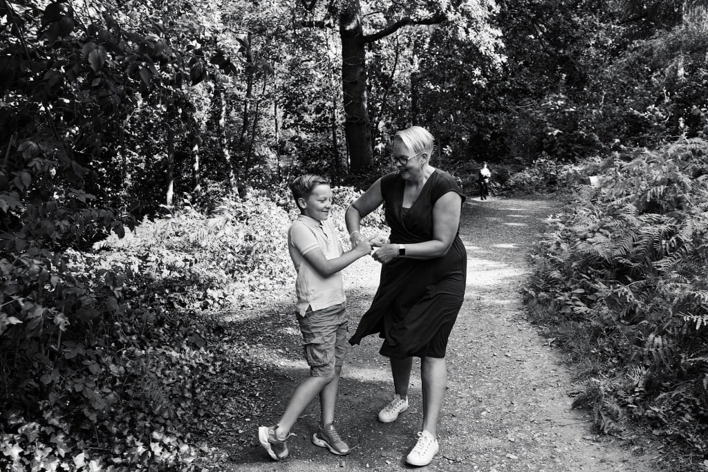 Mother and son play fight during a family session at Scadbury Park in Chislehurst