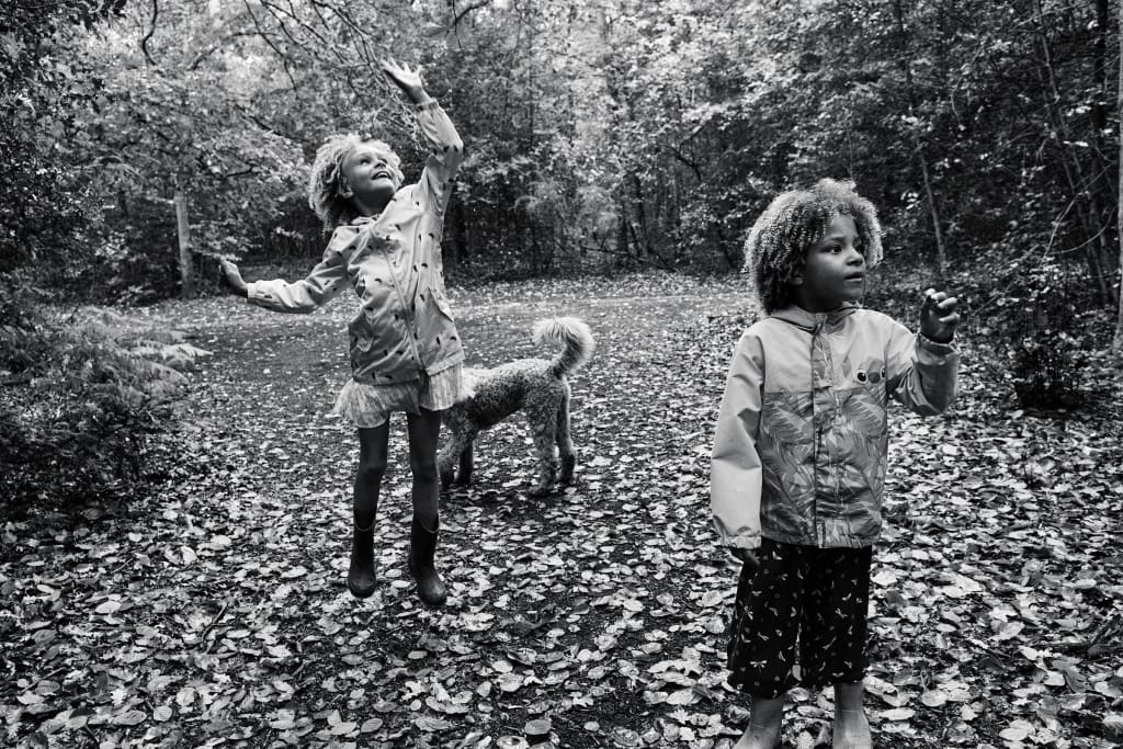 Photograph of sisters playing in the woods of Hayes Common in Bromley