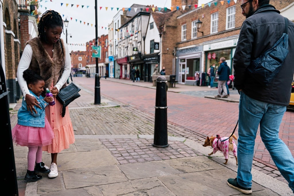 Photo of a child who is afraid for a dog passing by taken during a family photography shoot in Rochester Kent