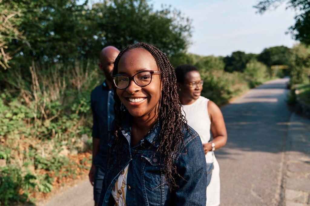 Smiling teenage girl looking at the camera during a family photography session in Bickley South-East London