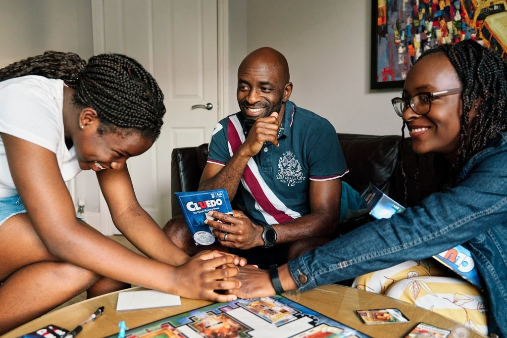 Family playing a boardgame together during a family photography session in Bickley Kent