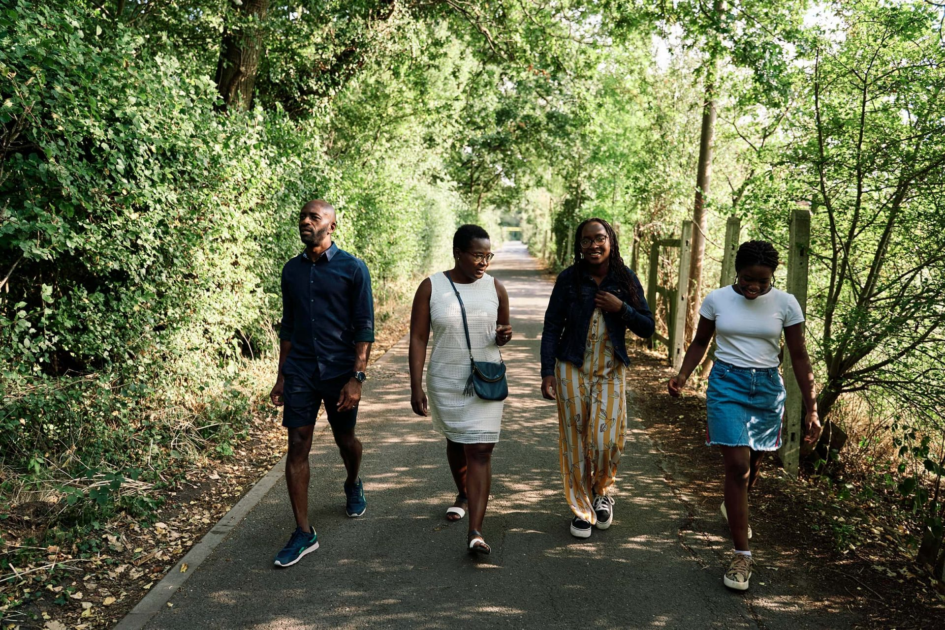 Family walking outside in a park during a photography session in Bickley London