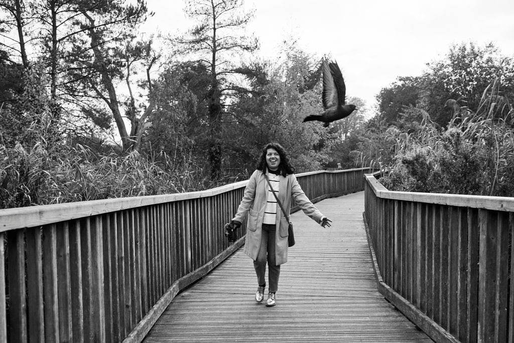 Benefits of personal branding photography are many, one is showing your personality like this joyful businesswoman chasing a bird during her photo session.