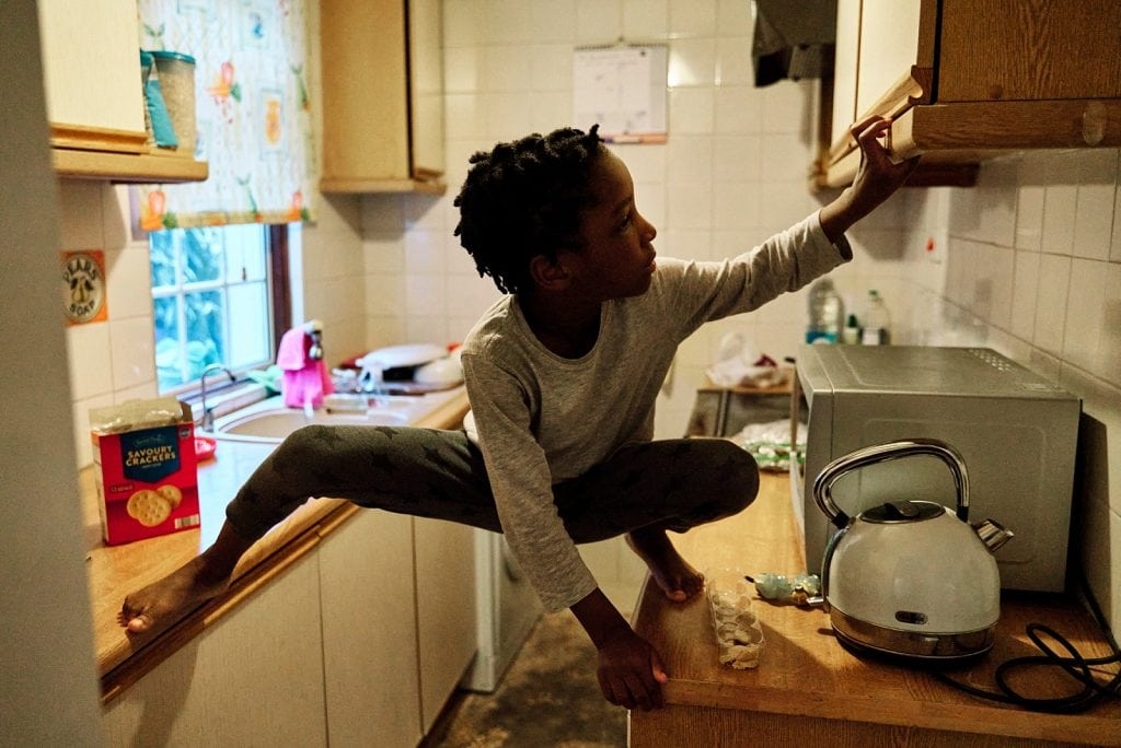 This favourite photograph of a boy in London climbing kitchen counters shows the intimacy I seek in my photography.